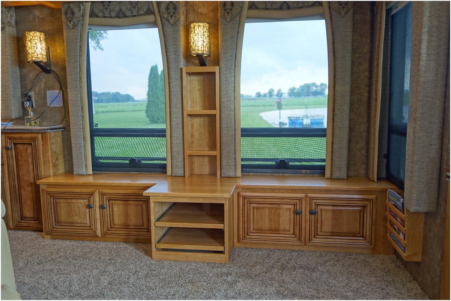 Custom cabinets built around windows