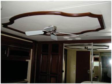 Wooden ceiling trim displayed with fan