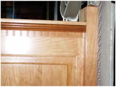 Intricate custom headboard with decorative detail