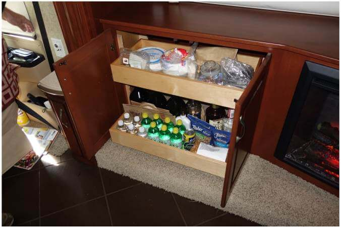 Cabinet with fireplace and plenty of pullout storage