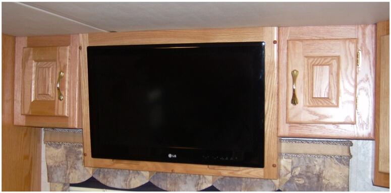 Custom RV bedroom TV cabinet mounted