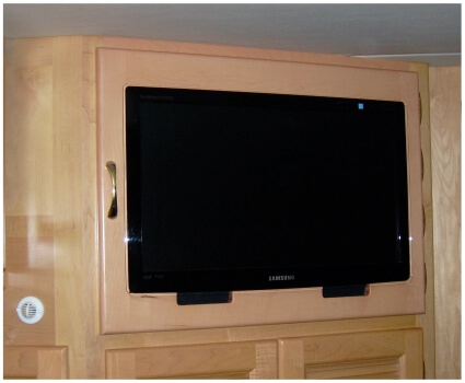 Custom bedroom RV cabinet with mounted TV
