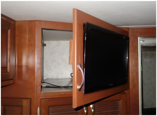 Bedroom TV mounted with swinging door