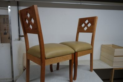 Two diamond chairs with light leather