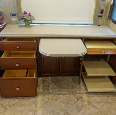 Custom counter with cabinets and pull out drawers
