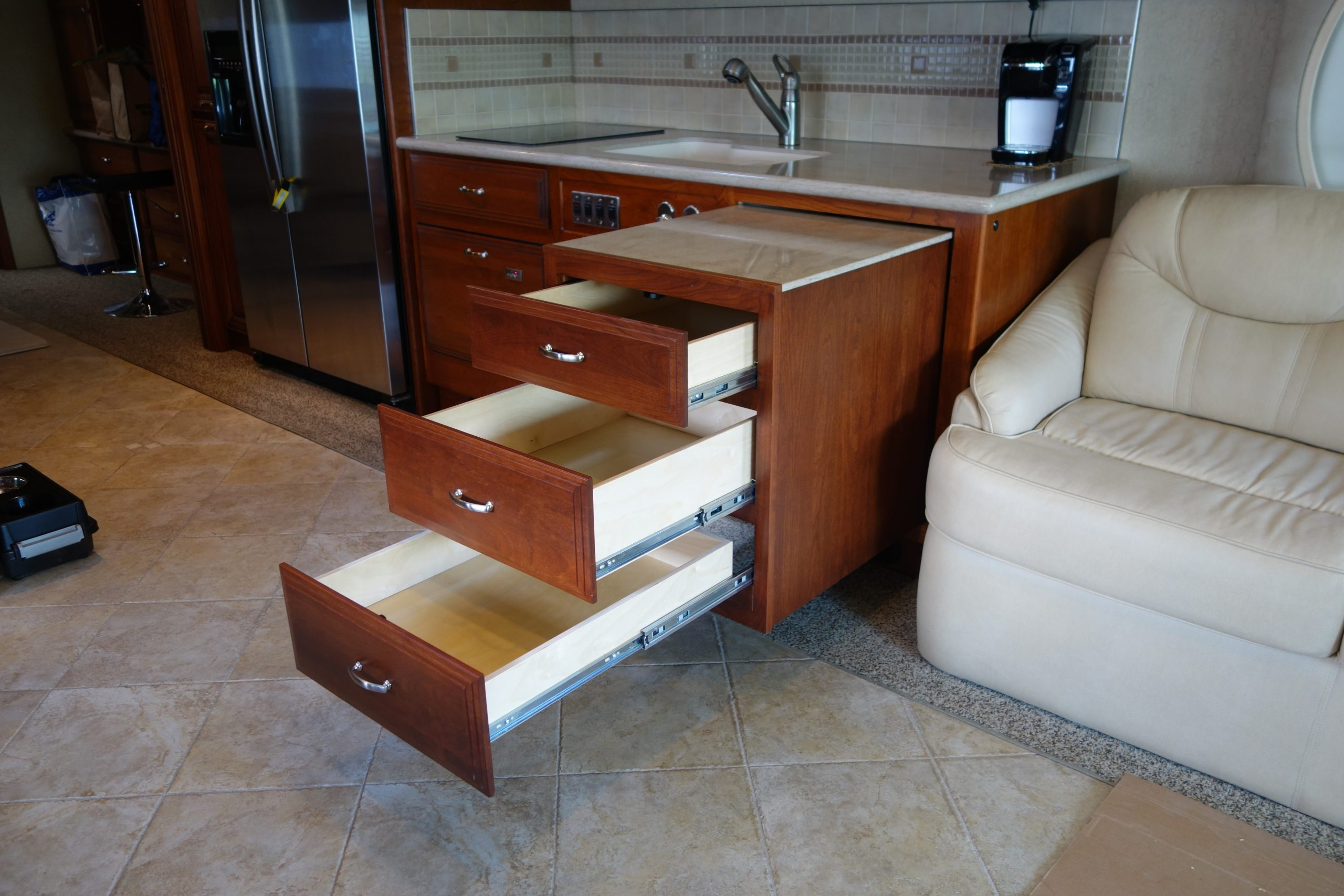 Pullout kitchen drawers with opened drawers