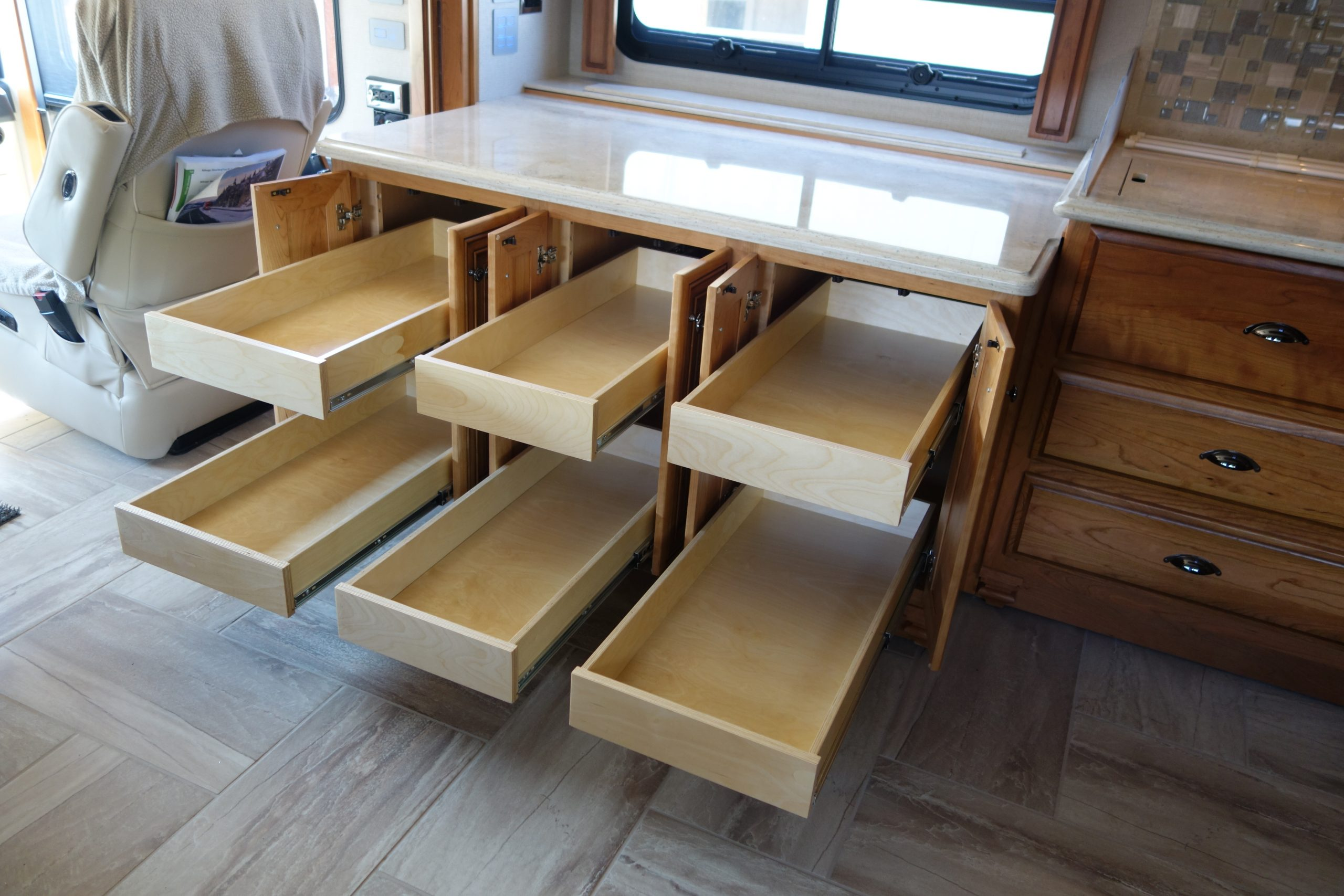 Custom cabinets with pullout drawers opened
