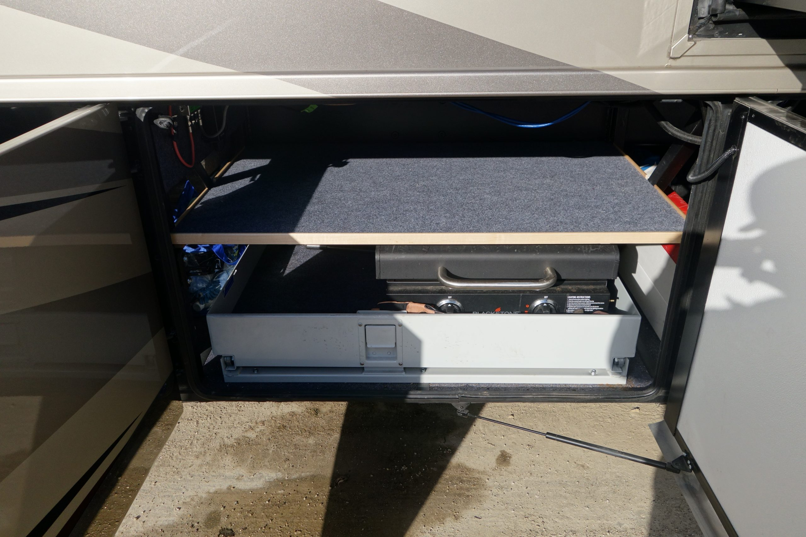Custom RV Storage Slideout Shown with Grill